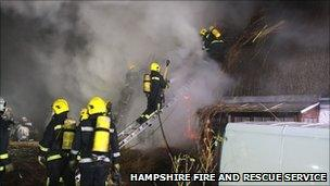 Firefighters at the thatched roof fire