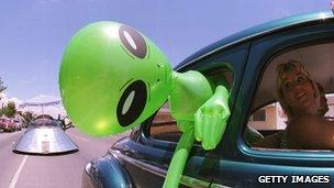 Alien head sticking out of car window (getty)