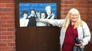 Vicky Perfect pointing to herself in the Courtalds Girls picture at Greenfield Dock, Flintshire