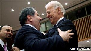 US Vice President Joe Biden (right) hugs Iraqi Foreign Minister Zebari (centre) before the start of a high-level UN Security Council meeting, New York, 15 December 2010