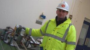 Berkeley site manager Sean Sargent with a model of the nuclear power plant, the way it was whilst operational