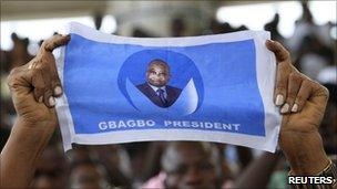 Supporter of Laurent Gbagbo holding poster (15 December 2010)