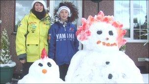 Carole and Dylan with their colourful snowmen at Llangoed, Anglesey