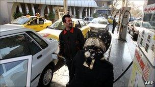 Motorists at Iran petrol station