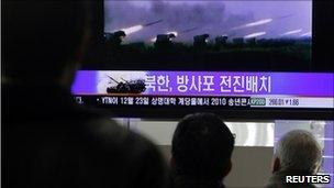 South Koreans watch news reports of drills in Seoul, 20/12