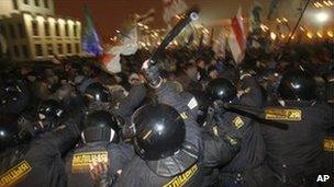 Riot police clash with demonstrators trying to storm the government building in the Belarusian capital, Minsk
