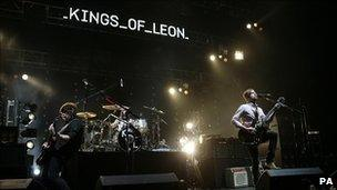 Kings of Leon perform live on stage