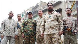 Men at checkpoint in Baghdad, originally hired to put Mehdi Army members behind bars