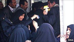 People queuing at a Tehran bank to receive payments promised under the new Subsidy Smart Plan