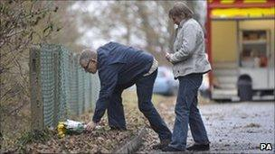 David and Theresa Yeates lay flowers at the scene in Longwood Lane