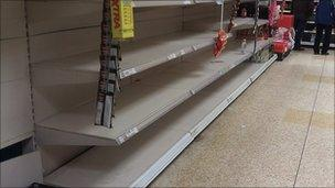 Empty drinking water shelves