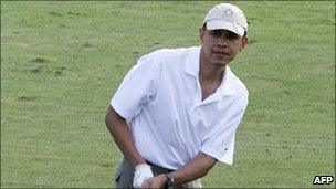 US President Barack Obama plays golf on the 9th hole at the Mid Pacific Country Club in Kailua, Hawaii (image from 28 Dec 2010)