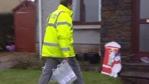 Bottled water being delivered in Carmarthenshire