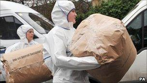 Forensic officers remove evidence from Jo Yeates' flat