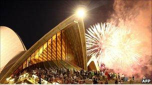 """Fireworks explode above the Sydney Opera House during the preliminary 9pm session as Sydney celebrates New Year""""s Eve on December 31, 2010 in Sydney, Australia."""