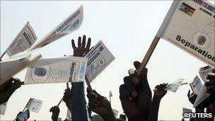 Southern Sudanese hold flags in support of the referendum