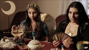 Romanian witch Mihaela Minca (R) talks to the Associated Press alongside her daughter and apprentice Casanndra in Mogosoaia, 5 January