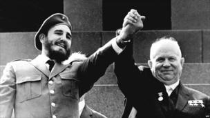 Fidel Castro shown in file photo dated May 1963 holding the hand of Soviet leader Nikita Khrushchev during an offical visit to Moscow