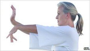 Woman practising Tai Chi