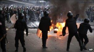 Egyptian riot police clash with anti-government activists in Cairo, Egypt