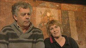 Rhodri and Angie Powell in front of the mural