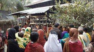 Crowd outside Hena Begum's house