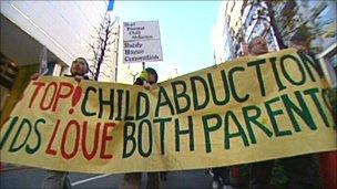 Lef-Behind Parents demonstrating