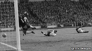 Geoff Hurst scoring his controversial second goal in the 1966 World Cup final
