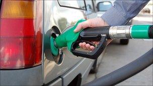 Driver filling up car