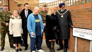 Private Tony Rawson's grandmother Olive Rawson, his parents, Ann Williams and Alan Rawson and with mayor Nirmal Singh Gill and soldiers