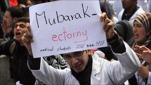 Egyptian medic holds an anti-Mubarak banner in Tahrir Square, 10 Feb 2011