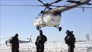 Romanian special police units send detained border officials away by helicopter. 8 Feb 2011