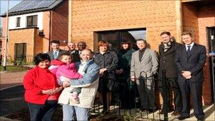 New tenants and council officials at the opening of the new homes