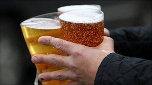 A man carries three pints