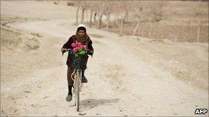 A boy riding in Helmand