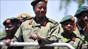 Uganda's President, General Yoweri Kaguta Museveni smiles as he inspects a guard of honour at Soroti, Uganda, Sunday 6 February 2011