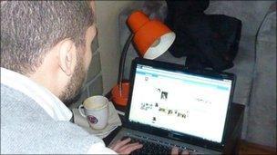 Man accessing Facebook site