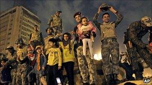 Egyptian Army soldiers celebrate with children on their armoured personnel carrier in Tahrir Square, Cairo, 11 February 2011