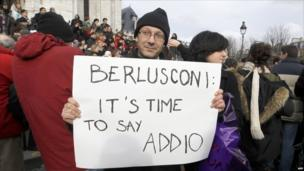 A man in front of the Sacre Coeur basilica in Paris at an anti-Berlusconi rally on 13 February 2011