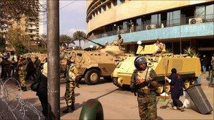 Egyptian troops outside the state TV HQ