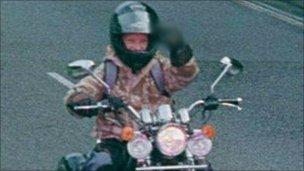 Rider making rude gesture