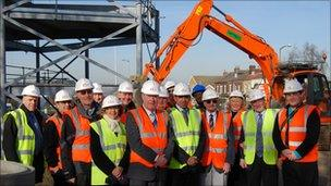 Representatives from organisations involved in the new youth centre view the start of the work