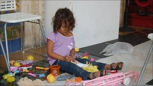 Child playing with her toys at the Venezuelan foreign ministry