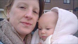 Tammy Gillam and her four-month-old daughter Abigail who had to leave their home because of flooding in Llincoln Courts