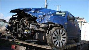 smashed car belong to Rachel McClean and Ryan Jones after it was hit by a train