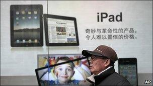Man walks past iPad advert