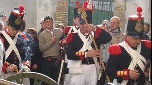 Gaeta locals watch soldiers prepare for parade