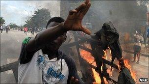 Supporters of Alassane Ouattara burn objects during a demonstration in the Abobo neighbourhood in Abidjan (February 2011)