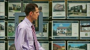 Man passes estate agent's window