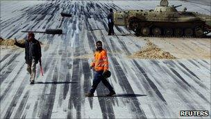 Protesters secure a runway in the eastern town of al-Abrak, 24 Feb